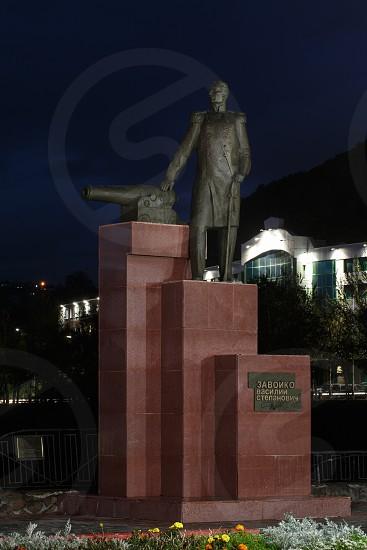 PETROPAVLOVSK-KAMCHATSKY CITY KAMCHATKA PENINSULA RUSSIAN FAR EAST - SEP 30 2017: Night architectural illumination of monument to first Military Governor of Kamchatka V. S. Zavoiko. photo