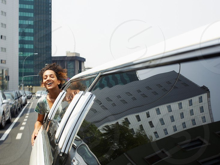 Woman; Women; Tourist; Limousine; head; window; happy; 20s; 25-30 years; Adult; breathing; Brunette; Car; carefree; city; Curly; enjoy; Enjoyment; european; Excitement; eyes closed; Female; freedom; freshness; Fun; Girl; Happiness; Hispanic; Latin american; Leisure; Lifestyle; Limo; Mid adult; open mouth; out; Outdoors; passenger; People; reflections; Rich; Smiling; street; Transportation; Two; Urban; vehicle; vitality; wellness; wind; young photo