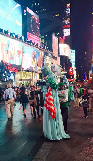 New York Times Square. 'Statue of Liberty' counting his dollars  photo