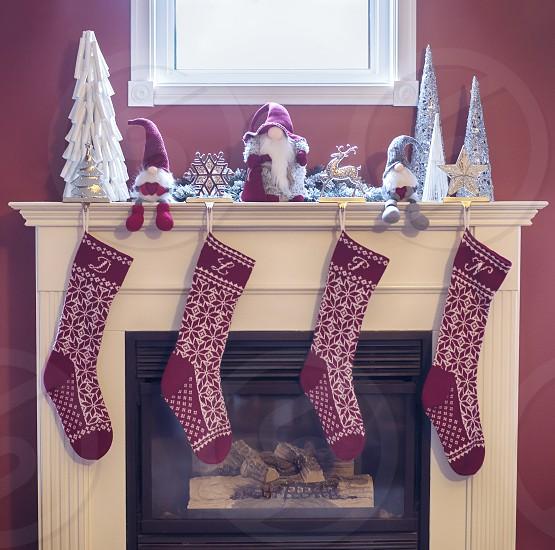 Christmas stockings hung on the fireplace. photo