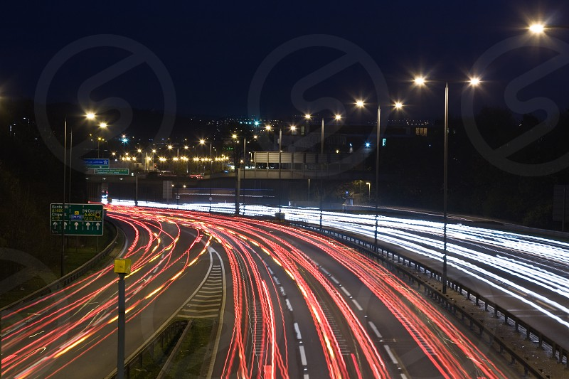 A 30 sec exposure photo taken by night over a busy motorway not far from London (probably the M11) showing white and red light trails left by car.   PS : No model release required. PS : I'm not sure if there's enough space for copy on my photo but it's nicely fit into the theme.  Thanks. photo
