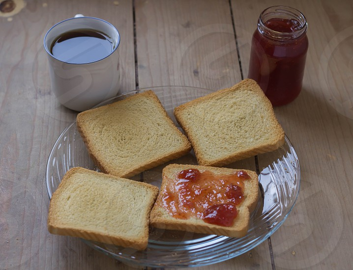 Strawberry jam with bread and coffee photo