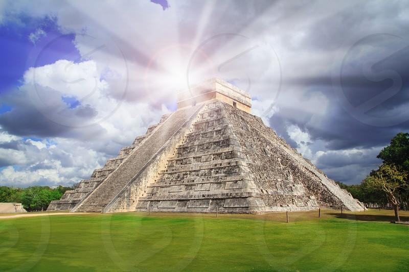 Chichen Itza Kukulkan Mayan pyramid sun beam Mexico Yucatan photo