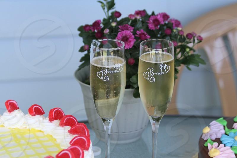 Wedding cake champagne Groom Bride flowers toast photo