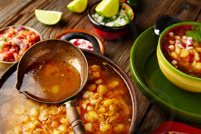 Pozole with mote big corn stew from Mexico in old cooking pot photo