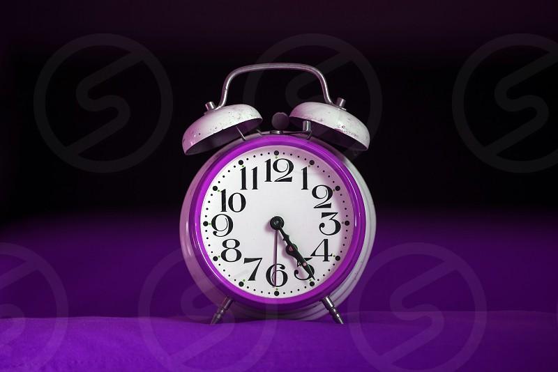 Retro alarm clock in ultraviolet color. photo