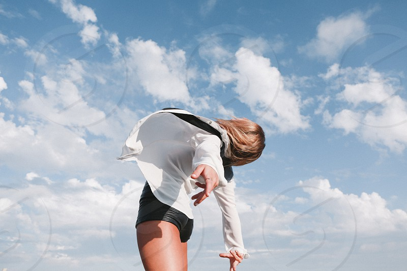 woman wearing a white shirt looking up photo