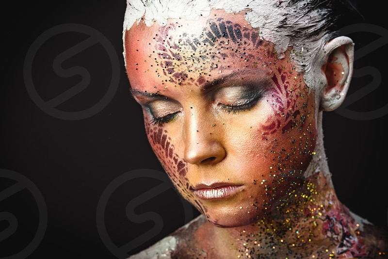 Portrait of Beautiful Young Woman with creative fantasy bird makeup photo