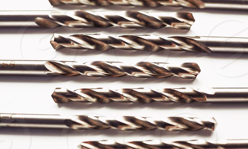 Closeup macro view of set of drill bits. photo