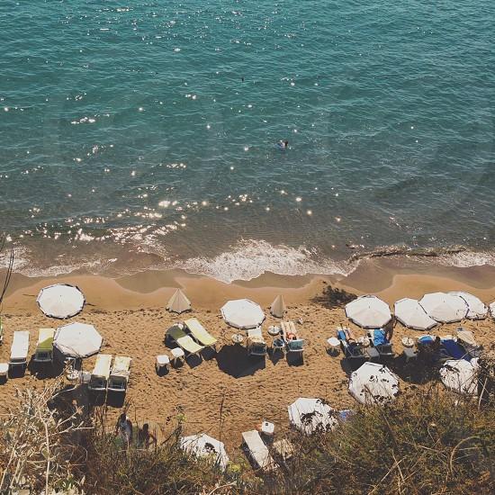 white outdoor umbrellas at beach shore photo