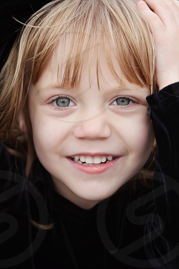 Close up photo of little girl smiling. photo