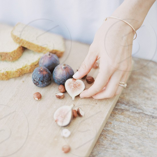 brown nut beside brown round fruit on brown chopping board photo