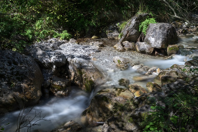 Tiny rapids at the Val Vertova torrent Lombardy near Bergamo in Italy photo