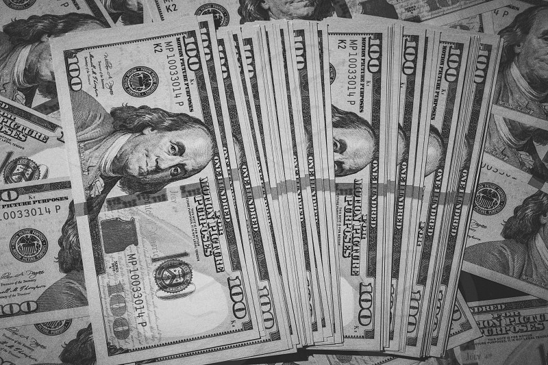 Stacks of 100 dollar bills  photo
