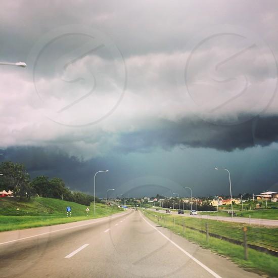 War of worlds. Rain storm thunderstorm  thunderstorms clouds highway Caribbean Trinidad grey stormy country doom landscape green asphalt journeys road trip photo