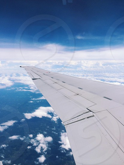 Airplane wing clouds arial view travel flight photo