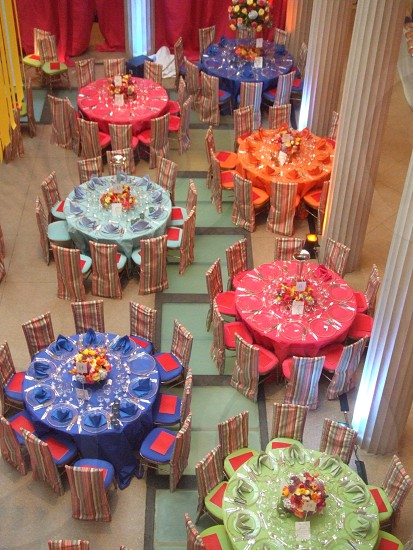 Special event venue set-up of colorful tables with decor photo