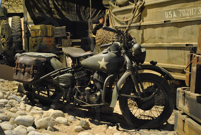 black vintage military motorcycle with brown leather saddle bags photo