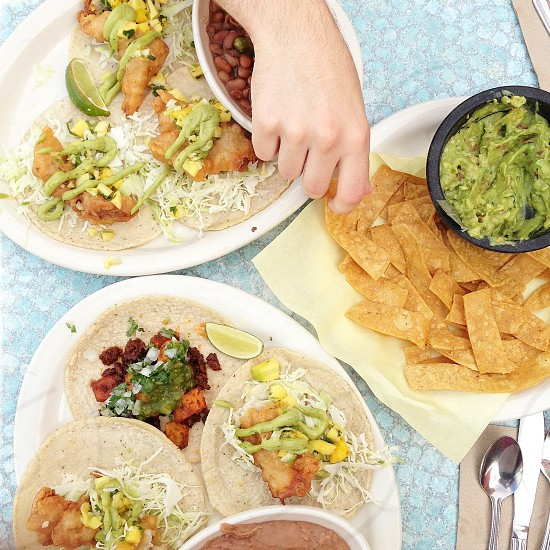 Fish & chorizo tacos served with chips & fresh guacamole photo