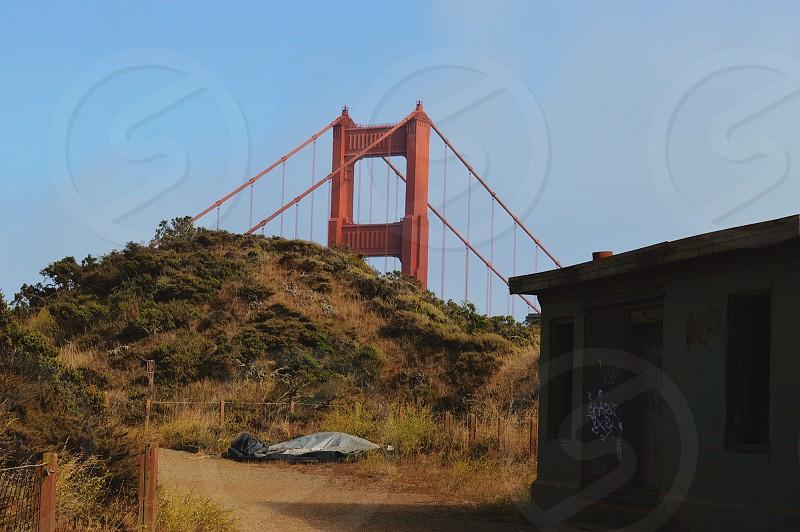 bridge behind hill photo