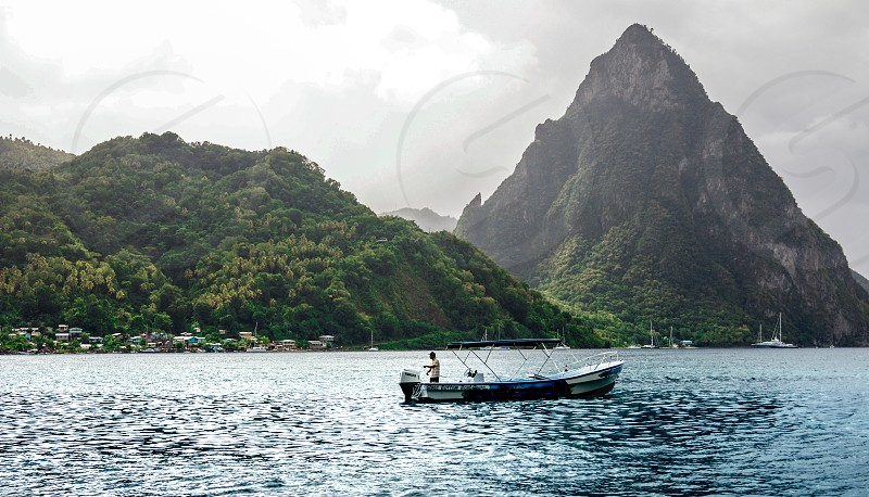 A scenic photo of a boat in a tropical ocean. photo