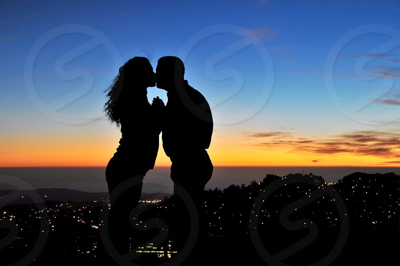 Lovers silhouette against a San Francisco Sunset photo