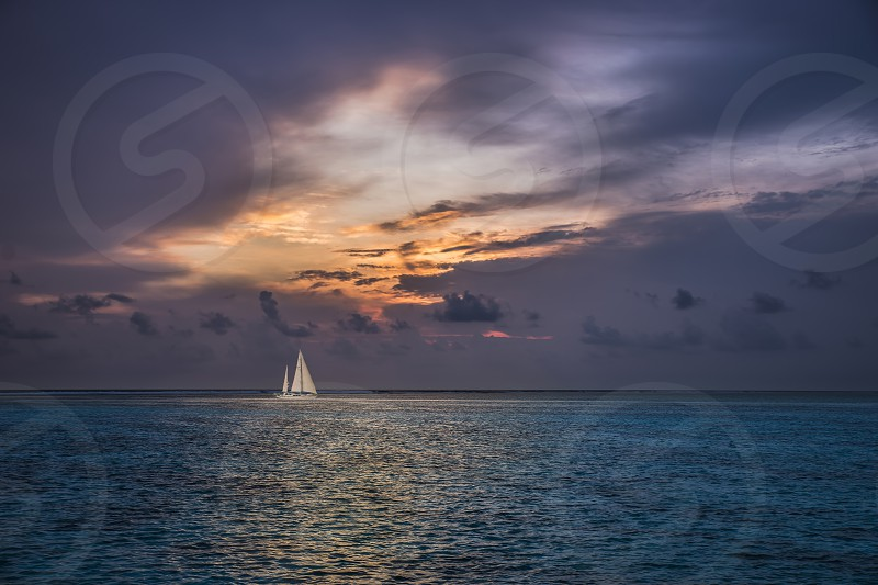 Remote and isolated sail boat photo