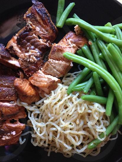 roasted meat with noodles and green beans photo