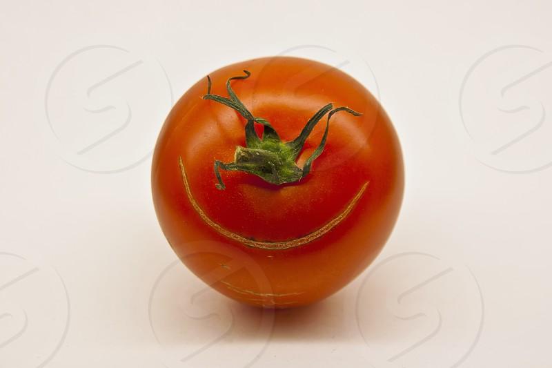 Happy tomato photo