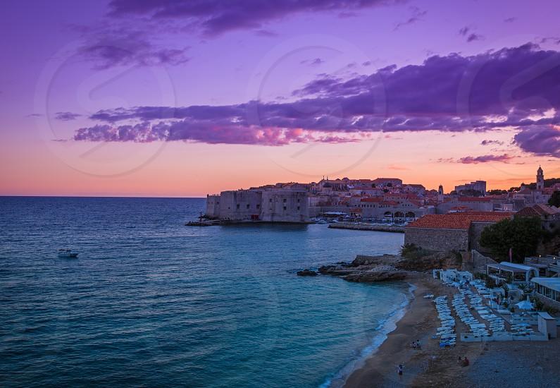 Dubrovnik Old Town Banje beach fort city walls sunset photo