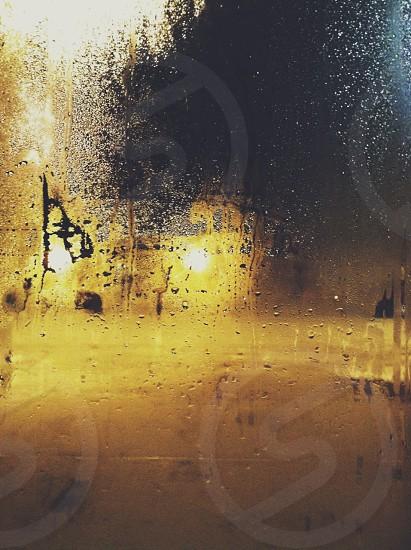 Fogged over window at night.  photo