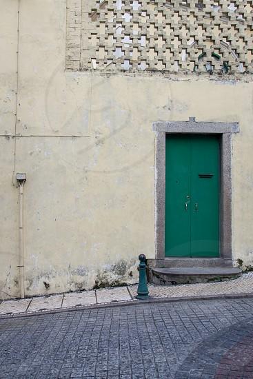 green post beside green door photo