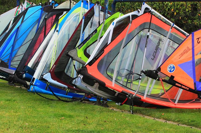windsurfing sails on grass during daytime photo