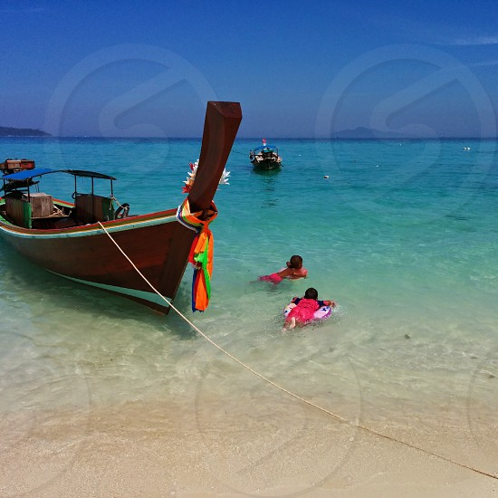Children swimming freely and happily at Koh Phi Phi photo