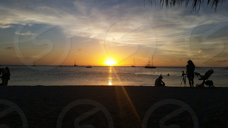 Sun Sunset Aruba Island Eagle Family Sand Sun Water Ocean Waves Sail boats vacation photo