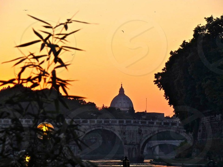 Sunset over Vatican City from the banks of the Tiber River. photo