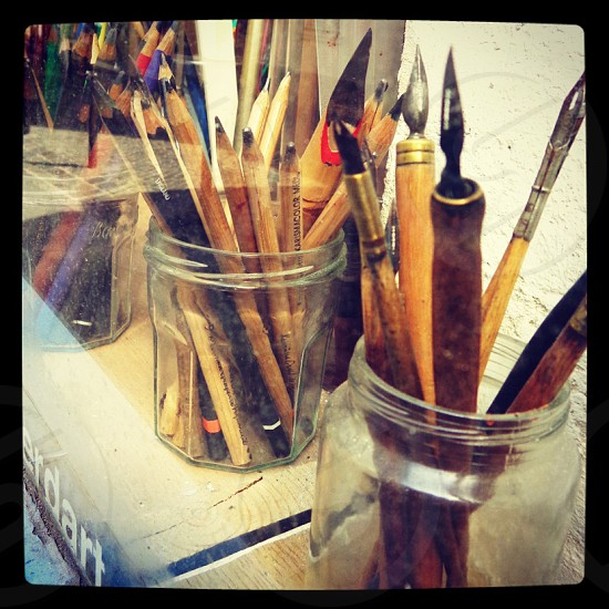 An artist's dream... paintbrushes and colored pencils photo