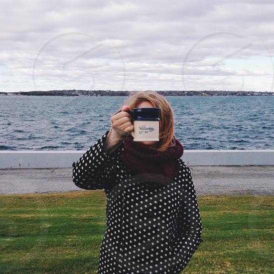 lady wearing maroon scarf photo