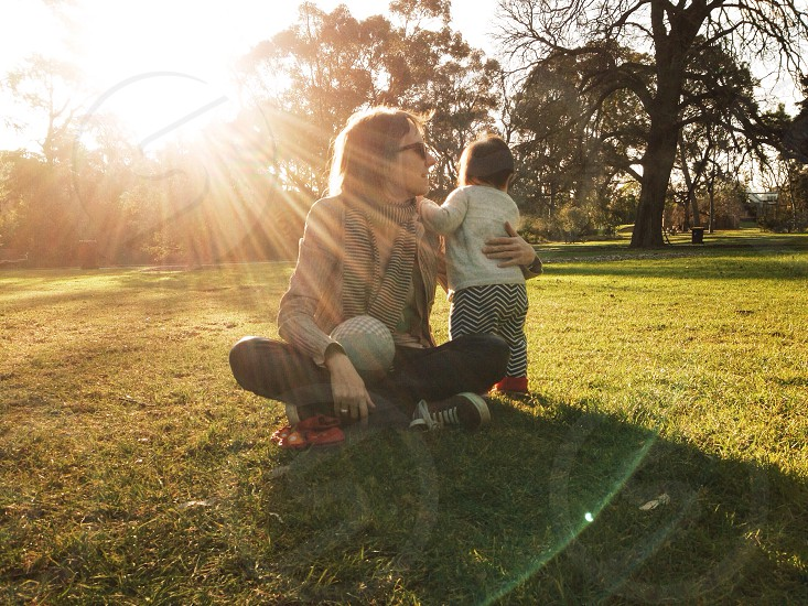 Mother & daughter playtime at the park at goldenhour. photo