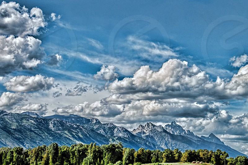 Windswept clouds cover the sky over a northern mountain range photo