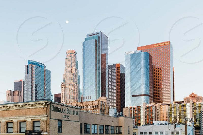 Los Angles skyline at sunrise with the setting moon   photo