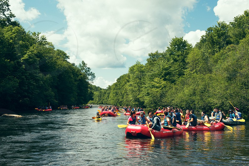 River rafting water sports group activity recreation photo