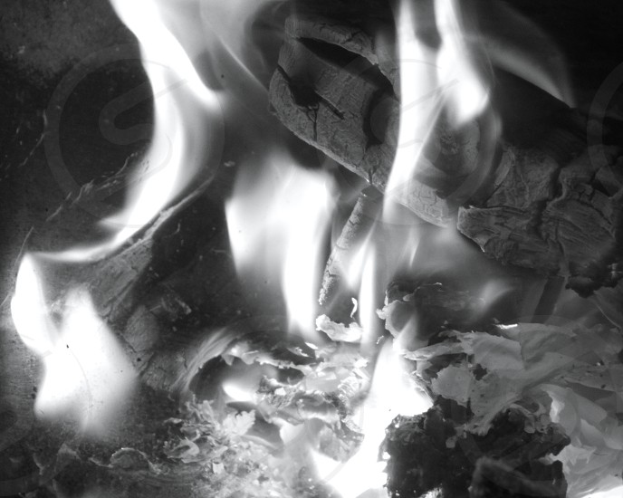 A black and white picture of close up of the middle of a fire. photo