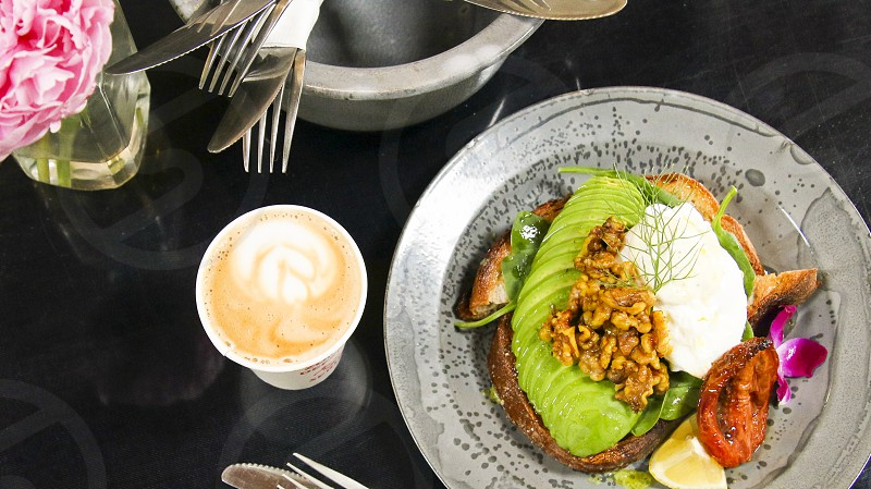 Avocado toast with fork bowl latte and peony photo