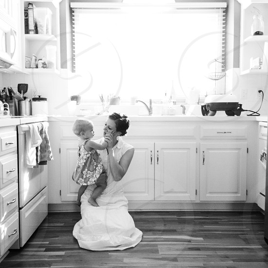 Woman child mother love light kitchen family photo
