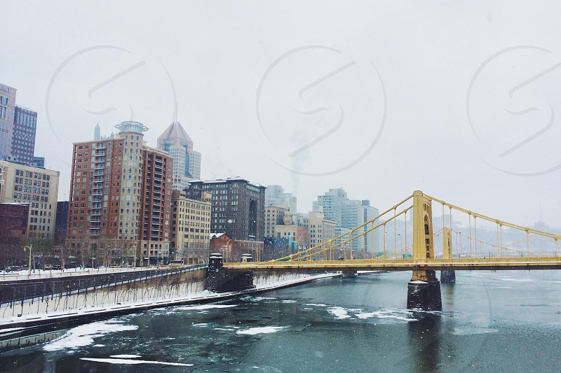 yellow metal footbridge photo