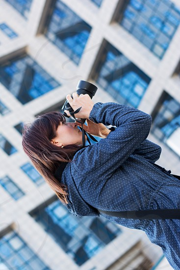woman photographer architecture building office glass windows exterior camera photo