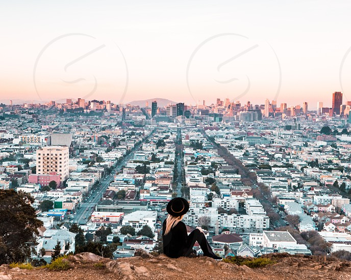 Girl overlooking city San Francisco. Travel. Explore. photo