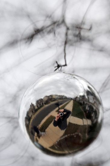 Photographer's reflection in a glass ball photo
