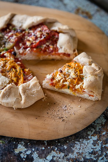 Fresh tomato galette with feta and herbs photo